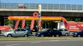 многонациональная : CZECH REPUBLIC, PRAGUE - JULY 11, 2015: worldwide gas station by the bridge in the center of the city