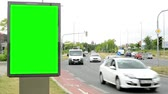 anlamlı : CZECH REPUBLIC, PRAGUE - JULY 13, 2015: billboard stands by the rush road in center of city - cars pass - green screen