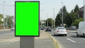 view of the billboard in the middle of the busy road in the suburb - green screen - timelapse