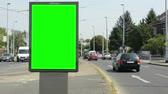 view of the billboard stands on the side of two roads in the suburb - green screen Vídeos