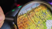 океаны : globe, North America, USA, Canada, view through magnifying glass