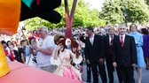 simbolismo : Mayor of Gabrovo, Bulgaria - Tanya Hristova symbolically cuts the tail of the cat and starts the carnival. May 20, 2017 Stock Footage