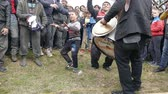 цыган : Todors Day. Feast of the horses. Small town in Bulgaria Pavlikeni 28. 02. 2015. Gypsy little boy expresses his musical talent. Стоковые видеозаписи