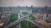 financial : shanghai cityscape traffic road junction roof top panorama 4k time lapse china