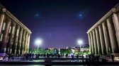 квадраты : Time lapse of the Trocadero Square in the busy city of Paris France, under an illuminated night sky with crowds enjoying the historical European architecture. Seamless Loop