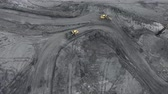 Aerial view open method of mining of coal, anthracite, whales, quarry dump trucks