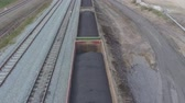 wagons : Aerial view UHD 4K of freight train with wagons and standing train with coal