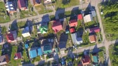 yards : Panoramic Aerial view over on residential houses in the countryside, yards and suburban communities in residential neighborhoods Stock Footage