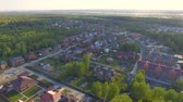 neighbor : Panoramic Aerial view over on residential houses in the countryside, yards and suburban communities in residential neighborhoods Stock Footage