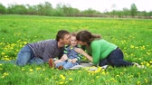 weather : young family on the meadow at sunny day Stock Footage