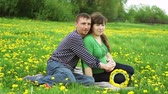 manmetro : husband and wife relaxing in a meadow