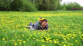 parent : father playing with his son in a spring meadow