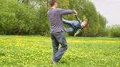 manmetro : father playing with his son in a spring meadow