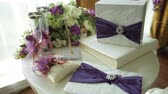 атрибут : table with wedding attributes and a bouquet of flowers for the ceremony Стоковые видеозаписи