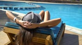 sensual : Pretty woman relaxing in a lounger near of the swimming pool. Consept of the travel vocation