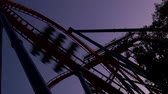 overcome fear : Silhouette roller coaster against purple sky, 4K Stock Footage