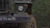 haki : Army Staff Russian truck driving on dirt road. Dirty armored vehicle. Stok Video
