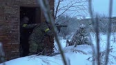 abandonar : military guard abandoned building in winter Stock Footage