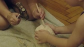 fingerprint : family playing in the archeology destroys the plaster to get the skeleton. archaeological excavations Stock Footage