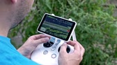 controlador : Man using a control panel drone. Aerial shooting from flying drone. Aerial view