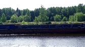 empty barge : Empty cargo ship floating along river in background forest. Cargo boat