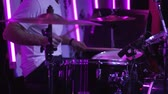 acoustics : Drummer man playing music on drums kit on concert stage at performance