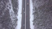 caminhão : Aerial landscape car driving on winter highway through snowy forest.