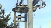 chairlift : Ski lift for transportation skiers and snowboarders on snow mountain in ski winter resort close up. Ski elevator on rope way in snow slope. Stock Footage
