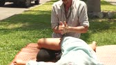 реабилитация : Professional massagist making thai massage to woman for healing and relaxation. Man doing yoga massage of female leg. Treatment and rehabilitation concept. Eastern medicine.