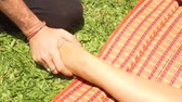 acupuncture : Close up foot massage in thai style outdoor. Yoga massagiste doing stretching foot massage to woman for healing and recovery. Thai and yoga massage in traditional asian medicine.