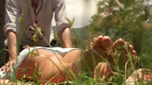 acupuncture : Woman receiving thai massage outdoor. Man massagiste doing massage in yoga style. Acupuncture massage for treatment body and spiritual health. Alternative and traditional indian medicine. Stock Footage
