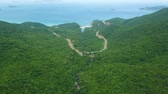 sarma : Winding road in mountains and blue sea landscape on horizon drone view. Highway road through green hills and beautiful sea from flying drone.