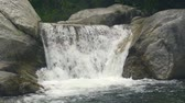bystřina : Beautiful waterfall flowing on large stones in mountain river. Flow mountain river in waterfall cascade.
