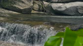 montanhas rochosas : Mountain river from waterfall flowing on large stones in tropical forest. Flow mountain river in waterfall cascade.