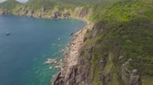 Landscape mountain cliff and sea ships sailing in blue drone view. Beautiful landscape from drone ships sailing in blue sea and rocky cliff on horizon. Stock Footage