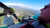 aerodynamics : Man flying on paraplane in sky, clouds and skyline landscape. Point of view paraglider flying on paraplane. Parachuting, parachuting concept. Active sport and extreme hobby.