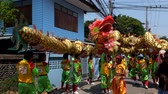 statue : BANGKOK, THAILAND - April 4 2015: Unidentified people of parade Local tradition Thailand, Thai people playing chinese lion dance to celebrate of Annual fair Buddhist Temple