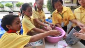 papier : BANGKOK, THAILAND - JUNE 9, 2016: Unknown children, Children make paper mache at Elementary School. Pieamsuwan school, Bangkok Thailand