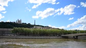 lyon : Soane river view with cathedrals Saint-Georges and Fourviere under blue sky white cloud in Lyon, France. Stock Footage