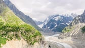mroczne : Timelapse of Drus , Mer de Glace glacier and Grandes Jorasses in the Mont Blanc massif during the cloud and rainy day in summer at Chamonix, French Alps