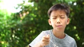 consumir : 4k of young Asian Thai boy eating rice in the garden