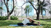 meditate : Young asian woman yoga outdoors keep calm and meditates while practicing yoga to explore the inner peace. Yoga and meditation have good benefits for health. Yoga Sport and Healthy lifestyle concept.