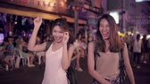 khaosan : Traveler backpacker Asian women lesbian lgbt couple dancing together. Female drinking alcohol or beer with friends and having party at The Khao San Road in Bangkok, Thailand.