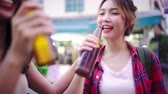khaosan : Traveler backpacker Asian women lesbian lgbt couple travel in Bangkok, Thailand. Female drinking alcohol or beer at The Khaosan Road the most famous street in Bangkok.