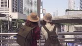 Traveler backpacker Asian women lesbian lgbt couple travel in Bangkok, Thailand. Happy young female spending holiday trip at amazing landmark and enjoy her journey in traditional city. Stock Footage