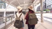 Slow motion - Traveler backpacker Asian women lesbian lgbt couple travel in Bangkok, Thailand. Happy young female spending holiday trip at amazing landmark and enjoy her journey in traditional city. Stock Footage