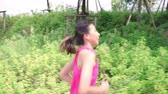 Healthy beautiful young Asian runner woman in sports clothing running and jogging on street in urban city park. Lifestyle fit and active women exercise in the city concept. Stok Video