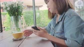 dish photo : Female blogger photographing green tea cup in cafe with her phone. A young woman taking photo of coffee tea on smartphone, photographing meal with mobile camera. Stock Footage