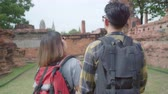egy fiatal nő csak a : Traveler Asian couple spending holiday trip at Ayutthaya, Thailand, backpacker sweet couple enjoy their journey at amazing landmark in traditional city. Lifestyle couple travel holidays concept.