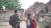 appunto : Traveler Asian couple spending holiday trip at Ayutthaya, Thailand, backpacker sweet couple enjoy their journey at amazing landmark in traditional city. Lifestyle couple travel holidays concept.